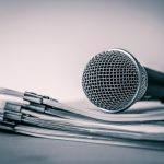 close-up-microphone-with-paper-document_25381-401